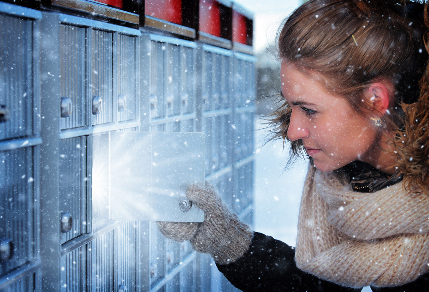 Pretty Woman Looking at Highlighted Mailbox in Winter - Stock Photography