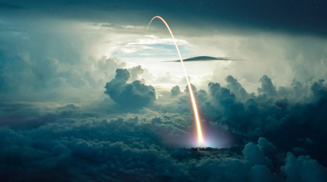 Missile Launch over the Cloudy Sky - Stock Photography