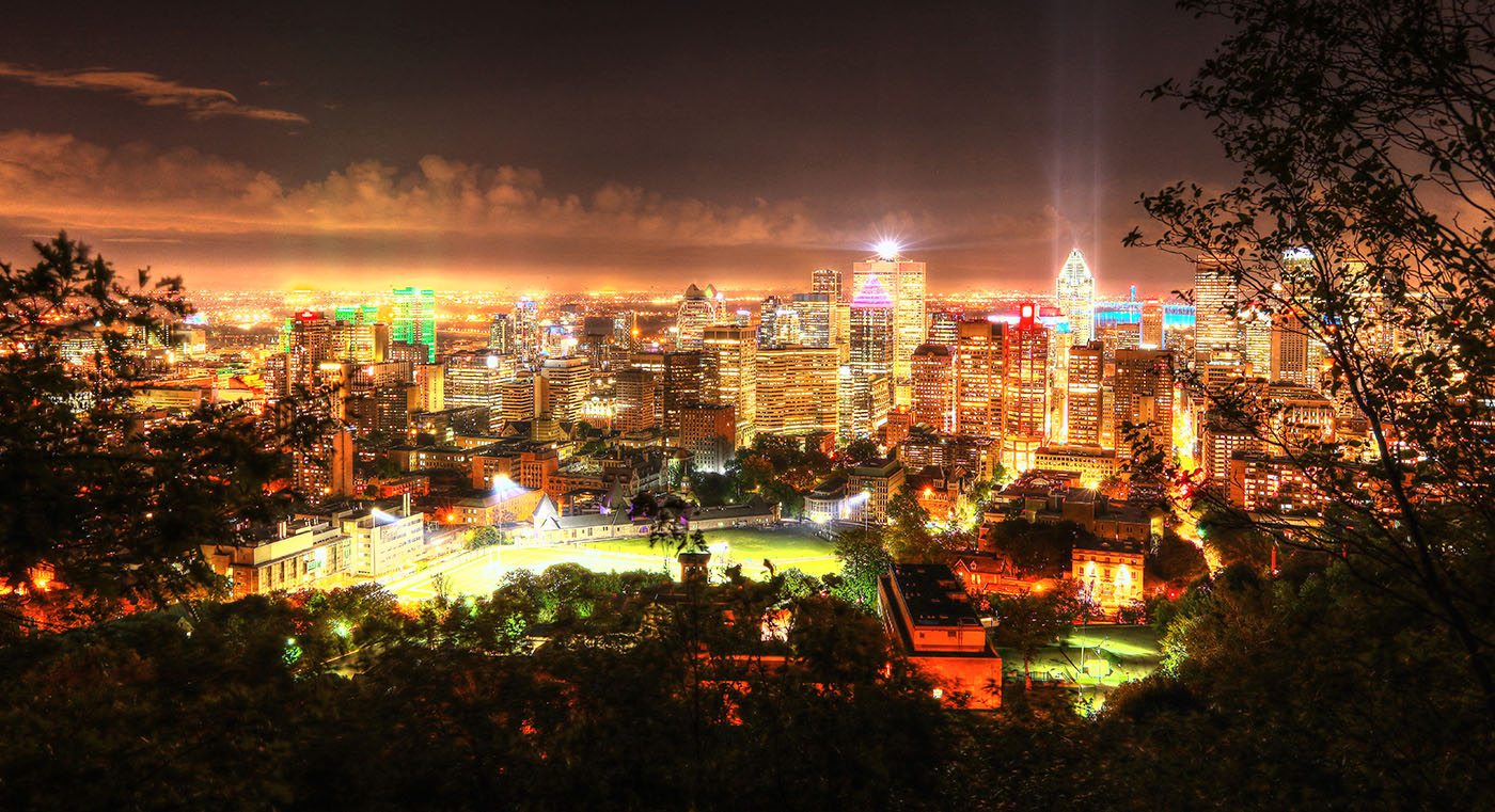 2020 Montreal City Sight at Night from the Mount Royal Hiking Trails - Stock Photography
