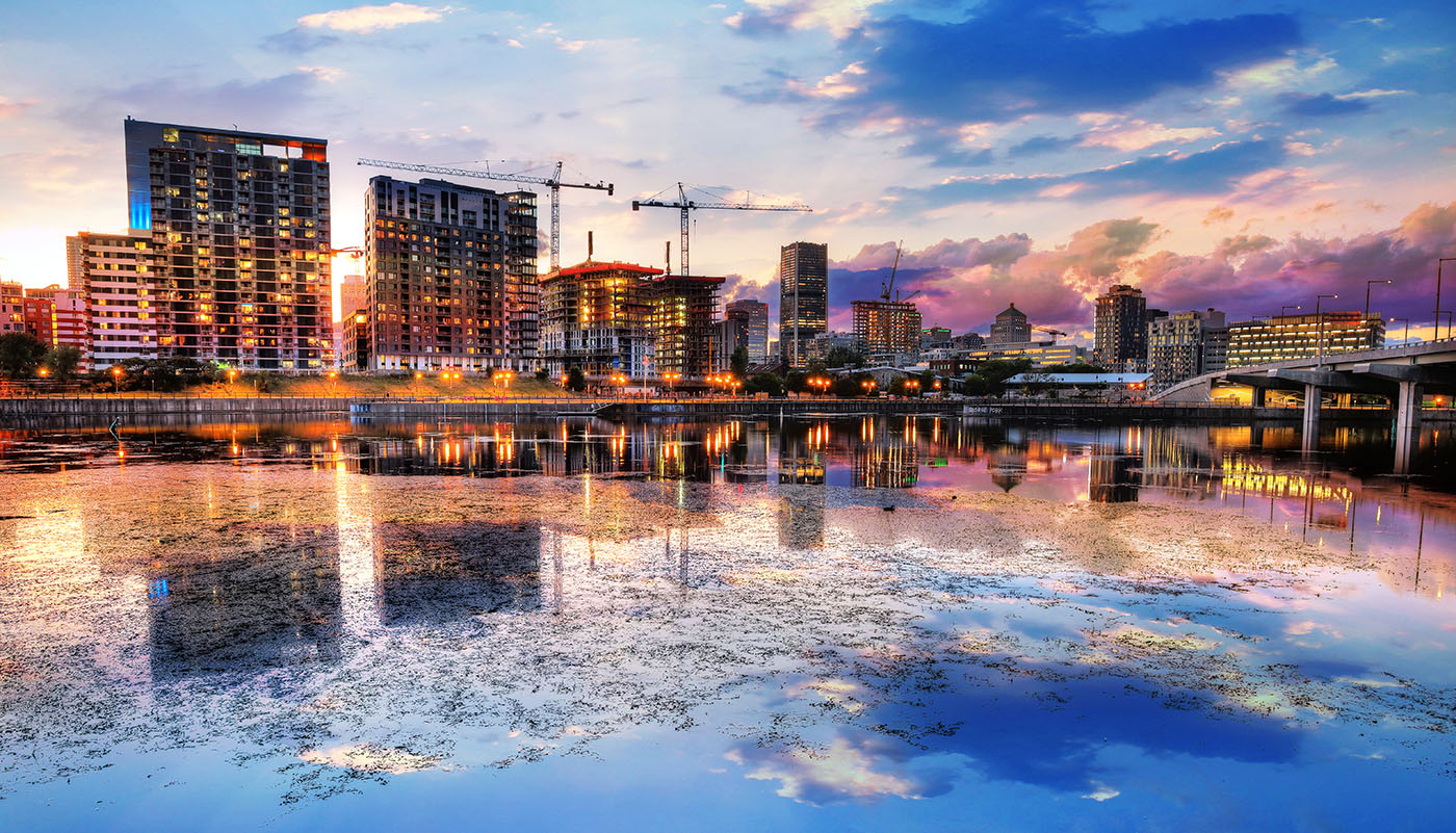 2020 Montreal City at Sunset with Water Reflection - Stock Photography