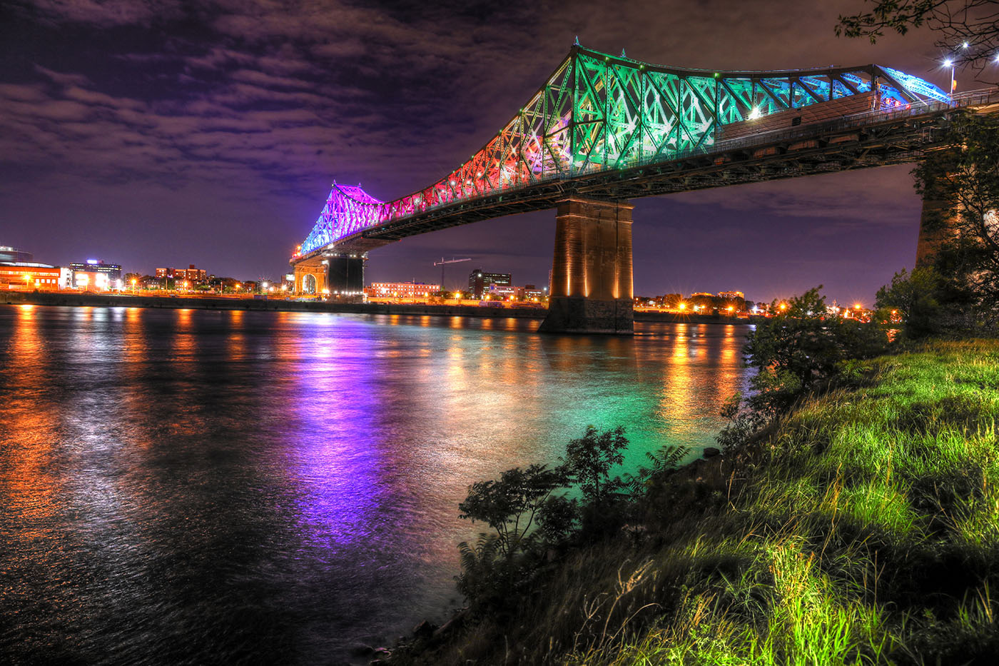 Colorful Jacques Cartier Bridge in Montreal City during Covid 19 - Stock Photography